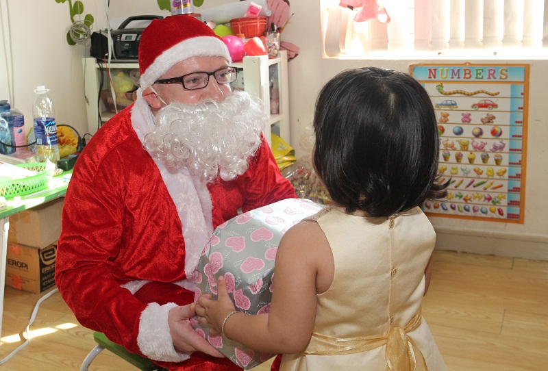 Santa Claus is giving gift to WASSers